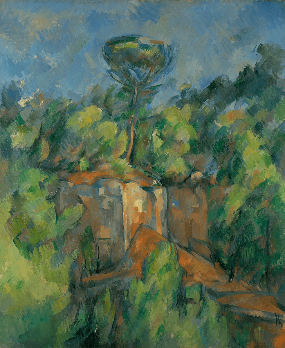A rocky, cliff formation surrounded by lush green foliage on all four sides. From the top of the outcropping, a lone tree grows up into the sky.