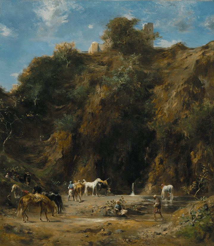 A group of Arabs resting and watering their horses in stream fed by water falling from a cliff. A building with towers can be seen on top of the hill.