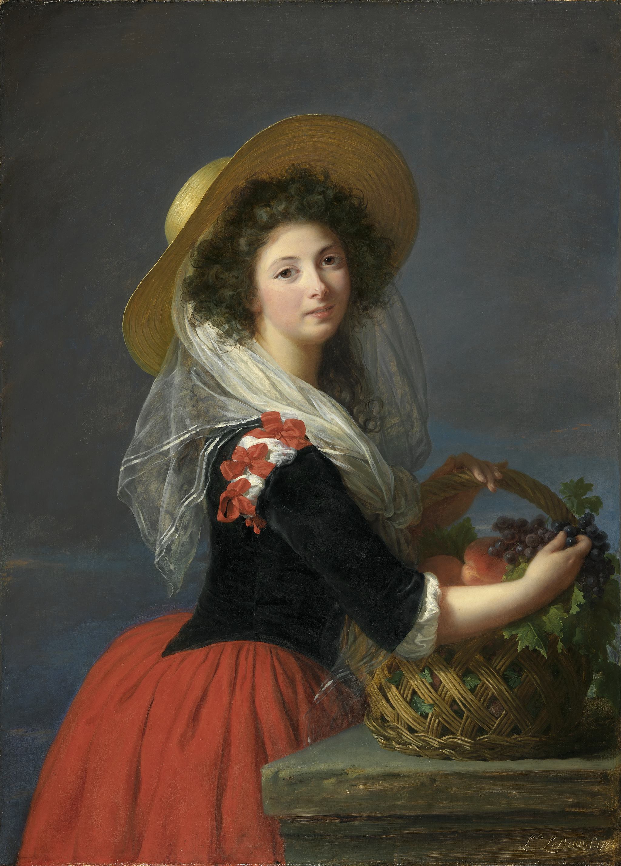 A young woman standing next to a ledge with a straw basket filled with fruit. She wears a scarlet skirt, black velvet bodice, and straw hat.