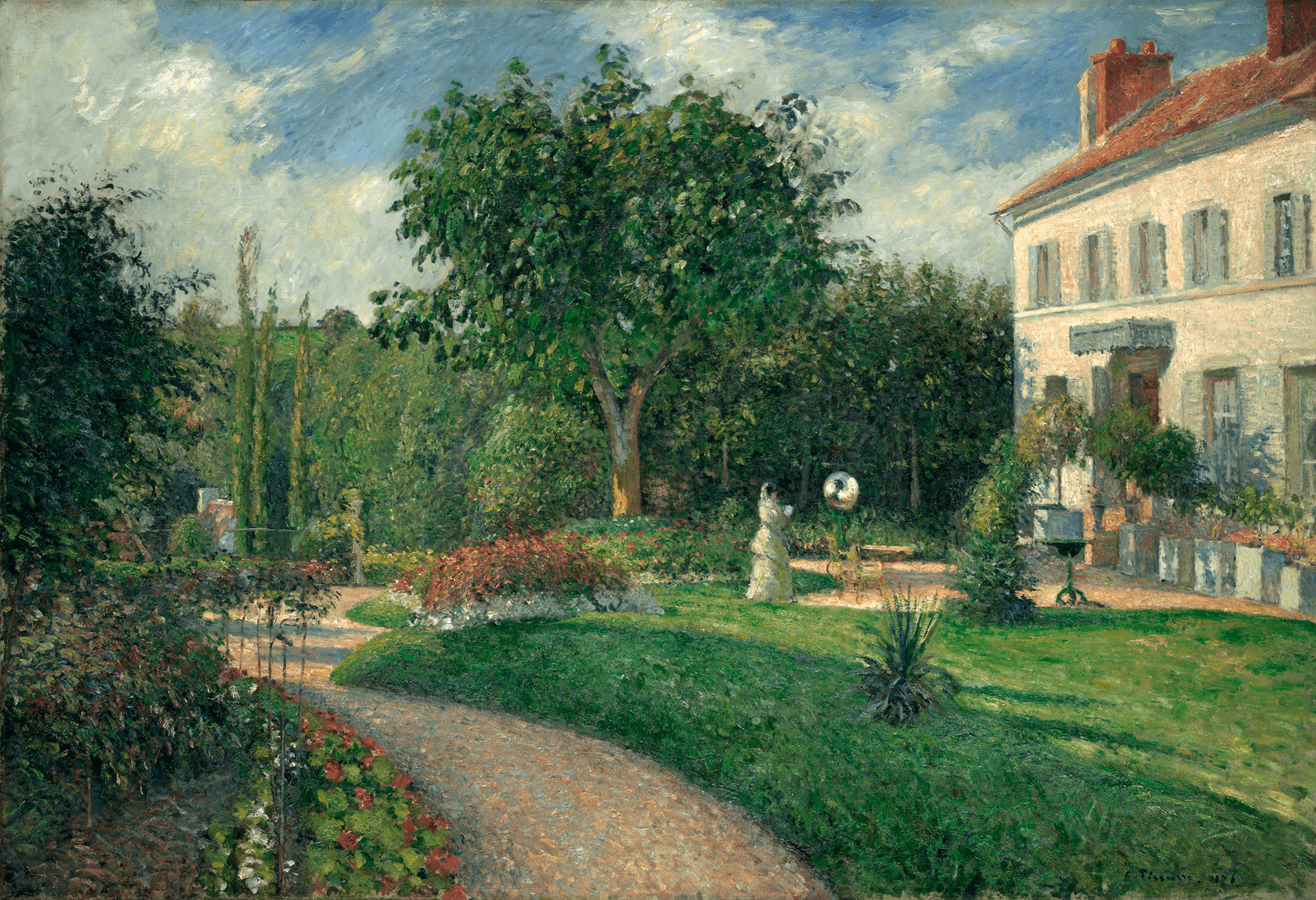 A path leads through a blooming garden. A white house is at the right and a woman stands before it