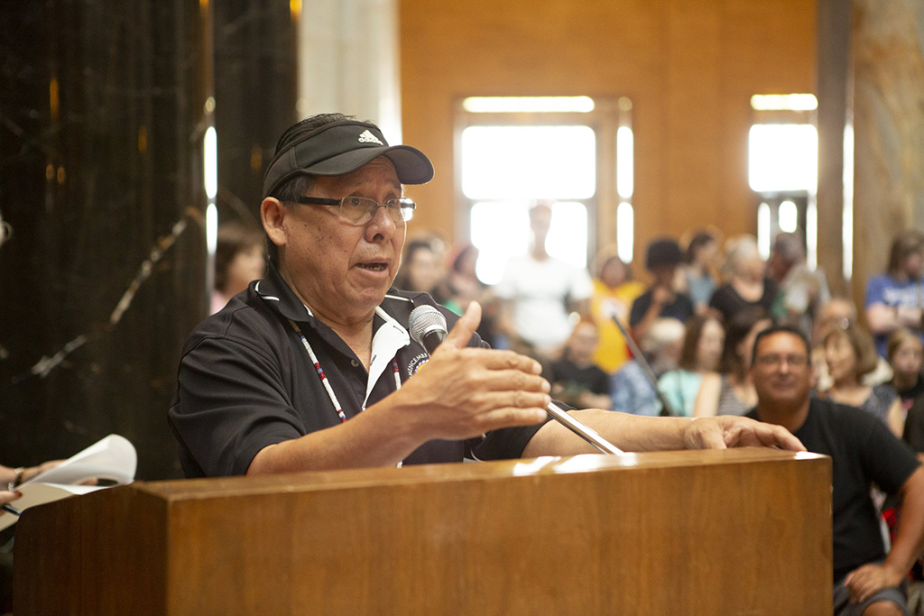 Manny King, Registrar at the Haskell Indian Nations University, delivers opening remarks following the Land Acknowledgment at the Native American Cultural Celebration in 2019.